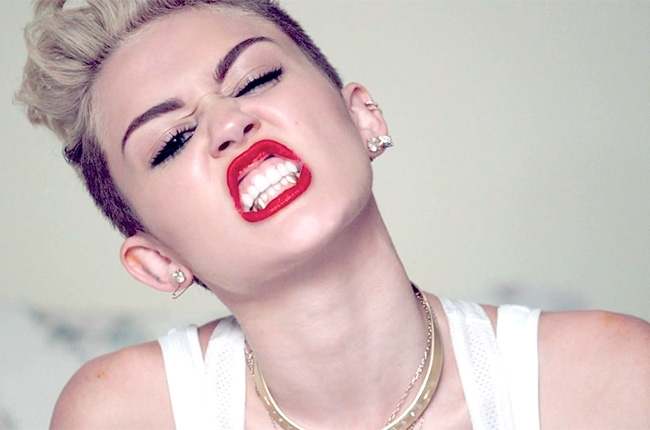"A still image from Miley Cyrus' music video ""we can't stop"" which was released this year."
