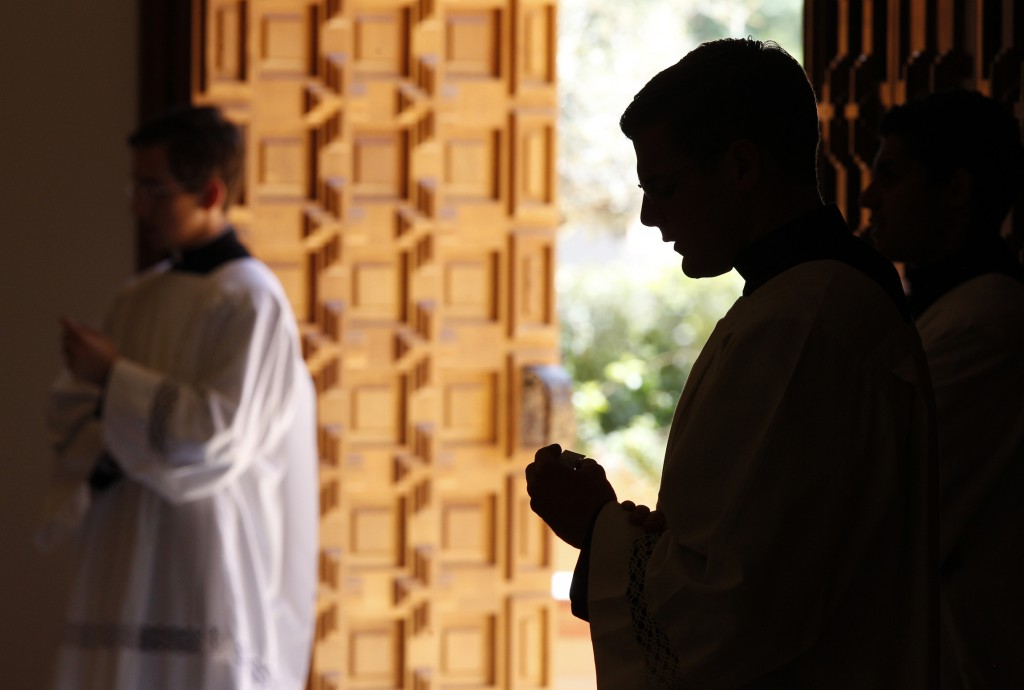 A Legionaries of Christ seminarian is silhouetted as he attends a Mass on June 7 with members of Regnum Christi in the chapel of Regina Apostolorum University in Rome.