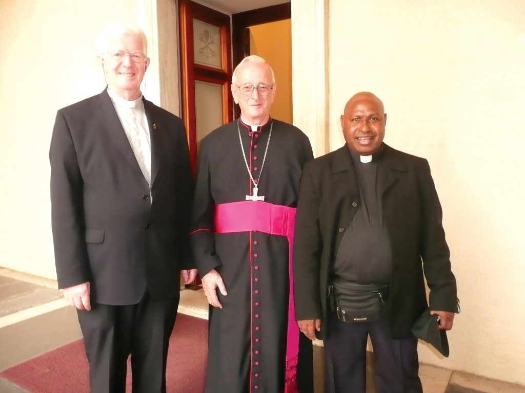 Bishop Anthony Burgess, centre, with two confreres. Bishop Burgess served God among the people on Papua New Guinea for 40 years. PHOTO: ACBC