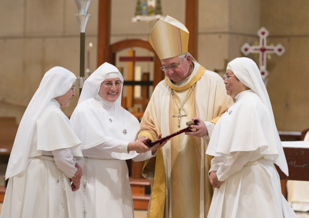 Los Angeles Archbishop Jose H. Gomez congratulates Sisters Pilar Vedoya, superior, Angelica Ramos, and Victorina Hernandez, all members of the Sisters Servants of Mary, during the annual White Mass at the Cathedral of Our Lady of the Angels in Los Angeles Oct. 27. The Archdiocese of Los Angeles and the Mission Doctors Association co-sponsored the Mass to honor all physicians, nurses and other health care professionals. PHOTO: CNS/Victor Aleman, Vida Nueva