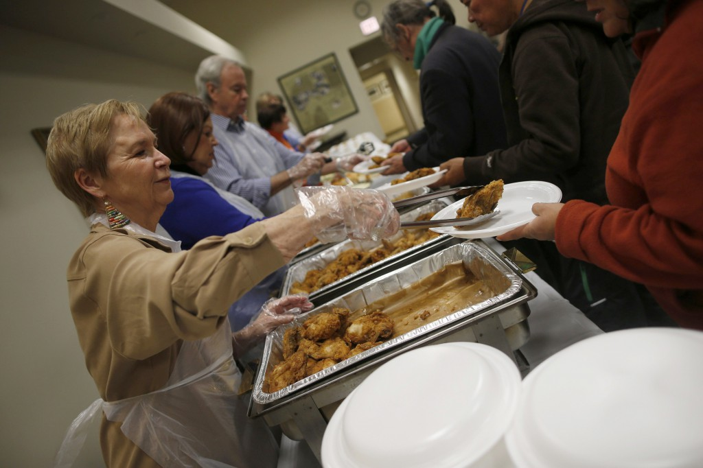 Volunteers serve people during a free dinner provided Nov. 1 by the Emergency Assistance Department of Chicago Catholic Charities. Archbishop Francis A. Chullikatt, Vatican nuncio to the United Nations, told world leaders Oct. 29 they must share one goal of food security so fewer and fewer people around the world will suffer from poverty and hunger. PHOTO: CNS/Jim Young, Reuters