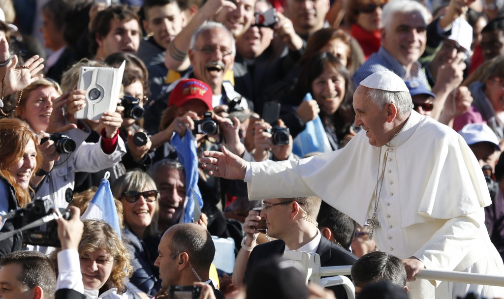 Pope Francis greets the crowd as he arrives to lead his general audience on Nov. 6 in St. Peter's Square at the Vatican. PHOTO: CNS/Paul Haring
