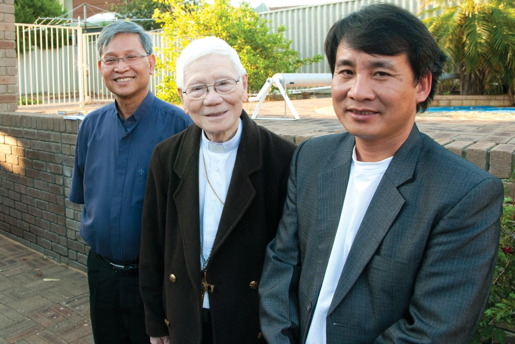 Bishop Paul Cao Dinh Thuyen, centre, the retired bishop of Vinh diocese in central Vietnam, says indefinite imprisonment awaits many Vietnamese asylum seekers whose claims are rejected. Bishop Paul, pictured with Vietnamese Catholic Community Chaplain, Fr Huynh Nguyen, left, and Fr Dinh Van Quynh, urged the immigration department to accept the claims of 26 detainees in Northam. PHOTO: ROBERT HIINI