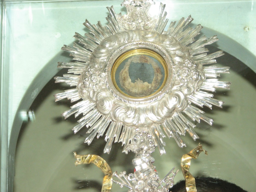 This is a photograph of the Miracle Host of the real Flesh of Jesus Christ which has been preserved in a monstrance for all to see and venerate in a church in Lanciano, Italy where the Eucharistic miracle happened in the year 700 A.D., some 1,312 years ago.