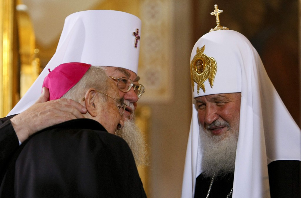 Russian Orthodox Patriarch Kirill of Moscow, right, and Metropolitan Sawa of the Polish Orthodox Church greet a Catholic clergyman at St. Mary Magdalene Orthodox Cathedral in Warsaw Aug. 16. The head of the Russian Orthodox Church made a historic visit to Poland with a message of reconciliation. PHOTO: CNS/Kacper Pempel, Reuters