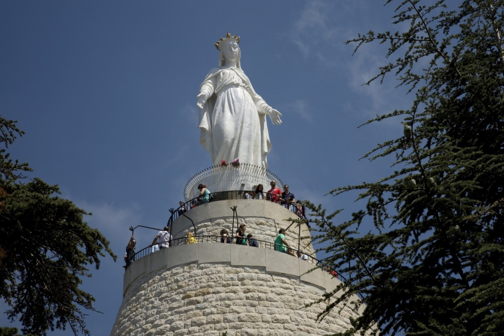 People visit the Shrine of Our Lady of Lebanon in Aug. 2012 in Harissa, east of Beirut. More than 800 Syrian and Iraqi refugees were bused to the National Shrine of Our Lady of Lebanon for a Christmas Mass. PHOTO: CNS/Dalia Khamissy