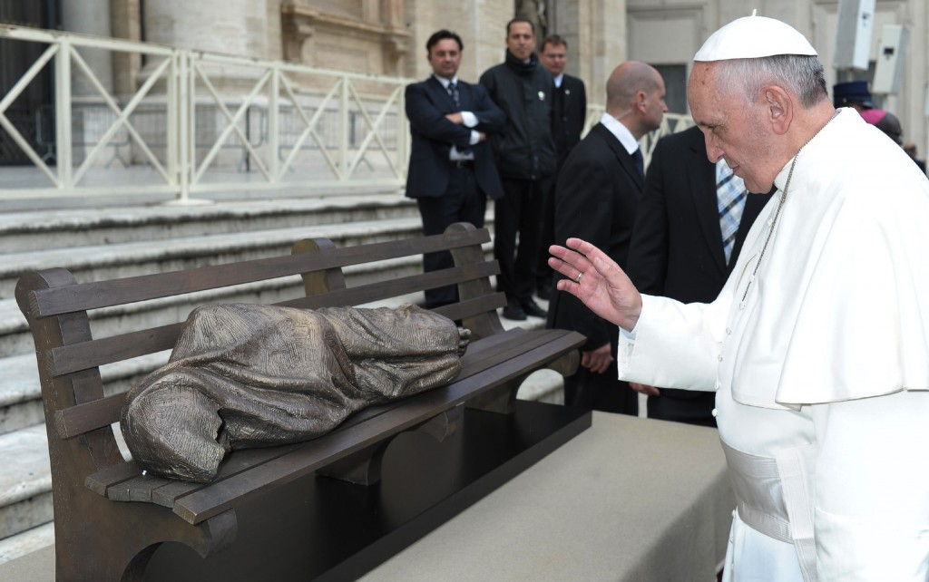 "Pope Francis blesses the sculpture ""Jesus the Homeless"" during his general audience in St. Peter's Square at the Vatican Nov. 20. The Vatican plans to install the bronze piece by Canadian Timothy Schmalz near Vatican Radio in memory of a homeless woman who died in the cold. PHOTO: CNS/L'Osservatore Romano"
