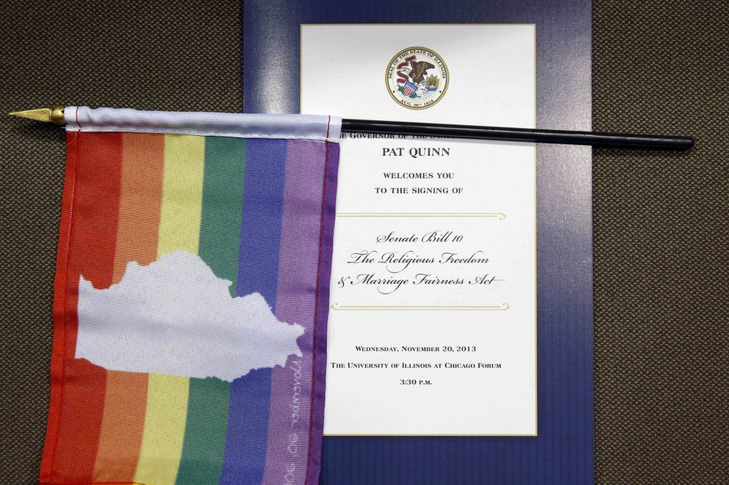 A flag is seen overlaying a program for a ceremony in late November to mark the signing of Illinois Marriage Equality Legislation in Chicago. As 2013 came to a close, New Mexico became the latest state to legalize same-sex marriage. Court cases on marriage are on the horizon in Michigan and Nevada for 2014. PHOTO: CNS/Jim Young, Reuters