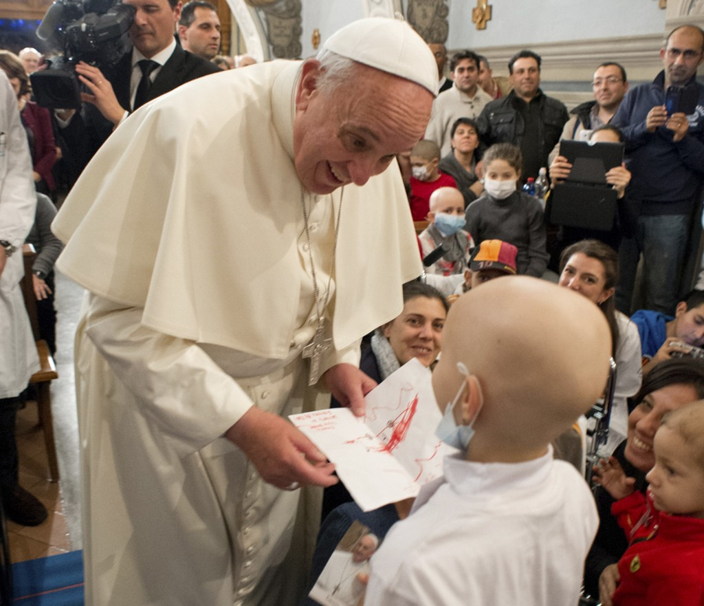 Pope Francis receives a letter from a child during a visit to the Bambino Gesu children's hospital on  Dec. 21 in Rome. PHOTO: CNS/L'Osservatore Romano via Reuters