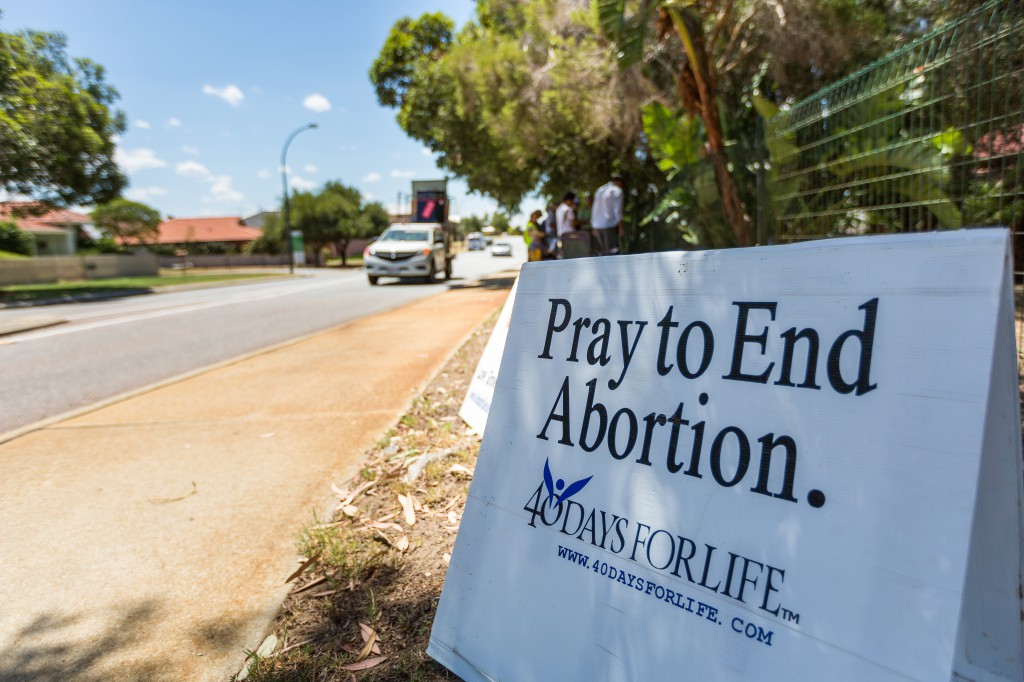 Catholics gather in prayer in front of an abortion clinic in Perth during the 40 days of life campaign in 2013.