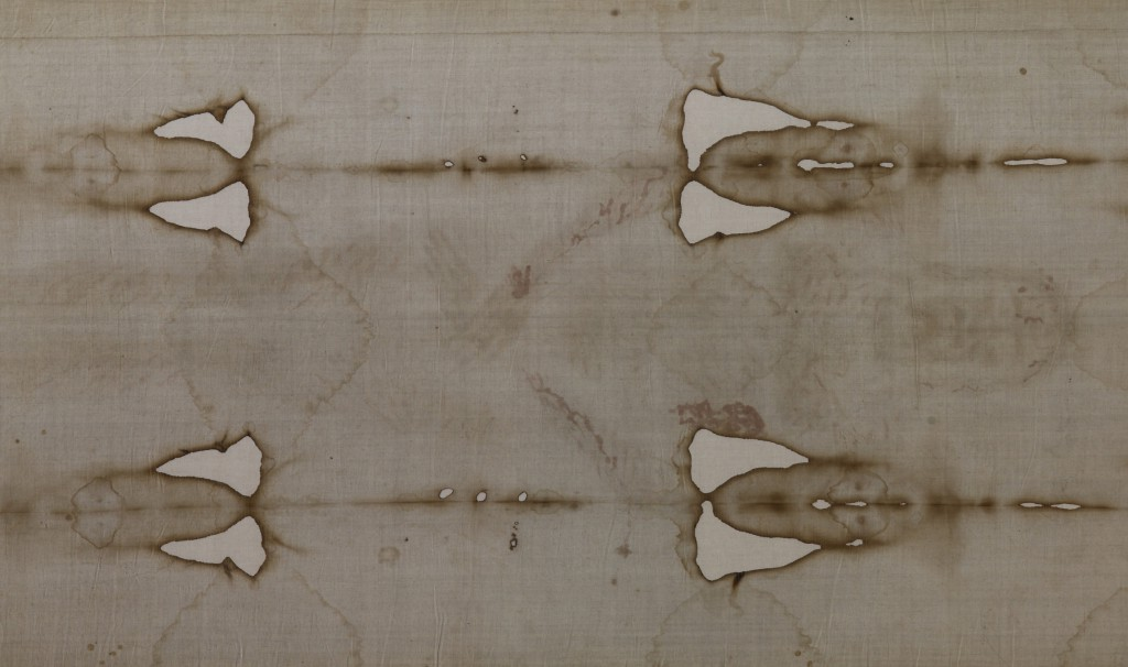 The Shroud of Turin is seen on display in the Cathedral of St. John the Baptist in Turin, Italy, in this 2010 file photo. The Archdiocese of Turin, custodian of the shroud, has announced that the shroud, venerated by many as the burial cloth of Christ, will be on public display April 19-June 24, 2015. PHOTO: CNS/Paul Haring