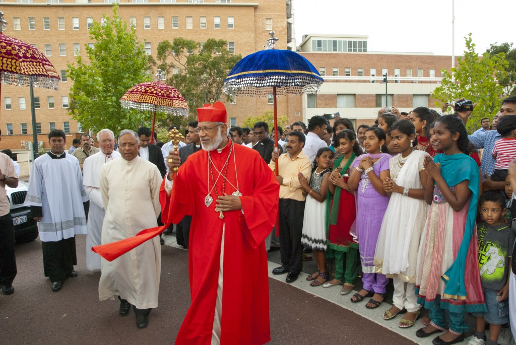 In a gathering rich with national pride and the colours of traditional dress, His Beatitude Cardinal Allencherry is welcomed to St Mary's Cathedral by members of Perth's Syro-Malabar community. PHOTO: Robert Hiini