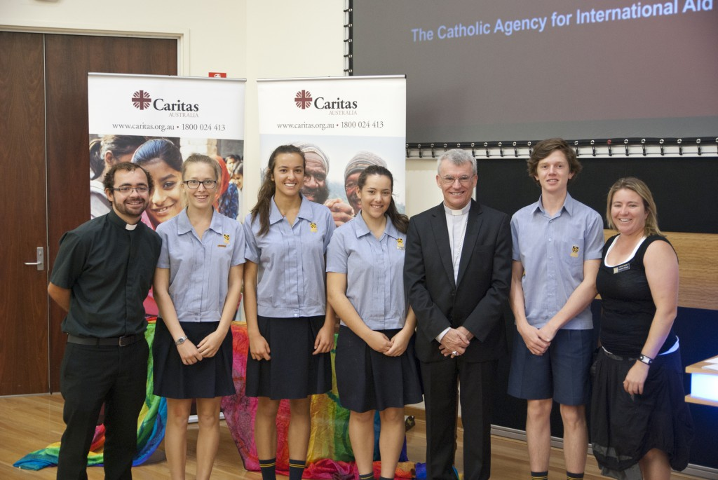 Archbishop Timothy Costelloe SDB with students from John XXIII College, college mission coordinator Caroline Watson and Fr Wilson Donizetti.