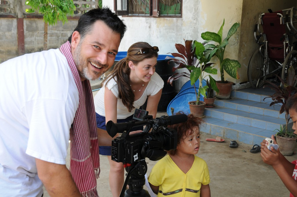 Tori Anderson, centre, who initiated the film Corridors of Children, pictured with a child in Thailand and the film's director, Cam Smeal.