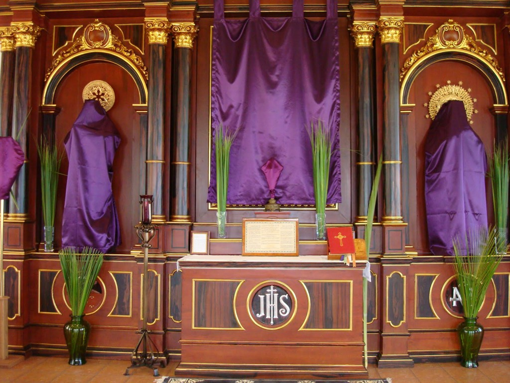 Statues of Saints and the main Crucifix can be seen covered by a simple purple cloth. If the Master himself is covered, so should be his servants.