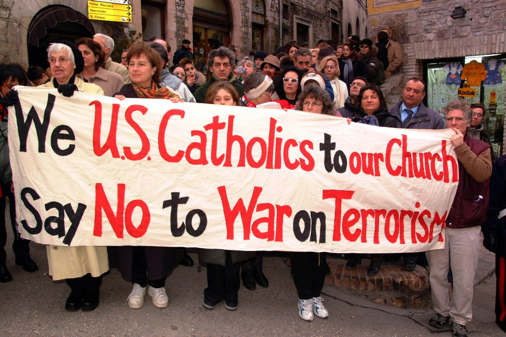 "Demonstrators hold a banner in January 2002 asking the U.S. church to ""say no"" to the war on terrorism in Assisi, Italy. PHOTO: CNS/Alessia Giuliani, Catholic Press"