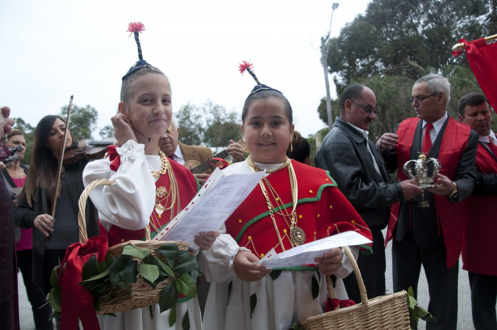 Two girls in traditional dress from Madeira sang devotional hymns to the Holy Spirit.