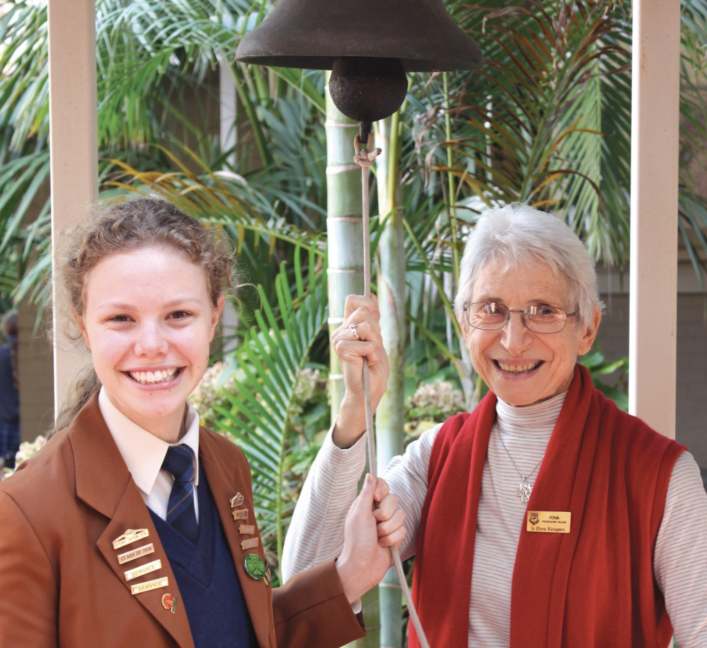 Liturgy captain Rebecca Hicks with Sr Flora Ricupero preparing to ring the Angelus bell at Iona Presentation College.