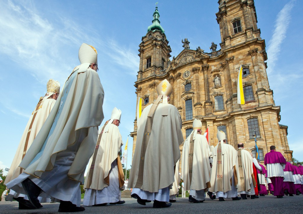 "Bavarian bishops walk in procession to the Basilica of the Fourteen Holy Helpers near Bad Staffelstein, Germany, in this 2012 photo. Germany's Catholic bishops have urged efforts to overcome ""destructive self-interest"" on the 100th anniversary of World War I, while recognizing the shared guilt of churches for the conflict, which left 16 million dead. PHOTO: CNS/Daniel Karmann, EPA"