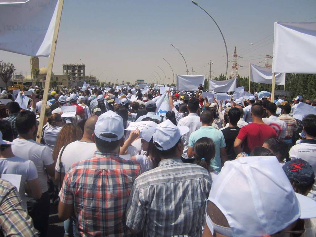 Christian refugees march against persecution by Islamic State fighters outside the U.N. compound near the airport in Irbil, Iraq, July 24. Christians braved temperatures as high as 122 degrees Fahrenheit to make their voices heard. PHOTO: CNS photo/Sahar Mansour