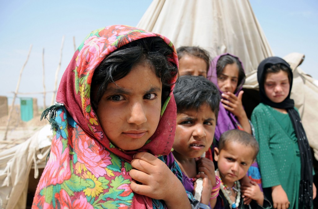 Afghan children are seen in late May at a temporary shelter in an internally displaced person's camp on the outskirts of Balkh province, Afghanistan. PHOTO: CNS/Sayed Mustafa, EPA