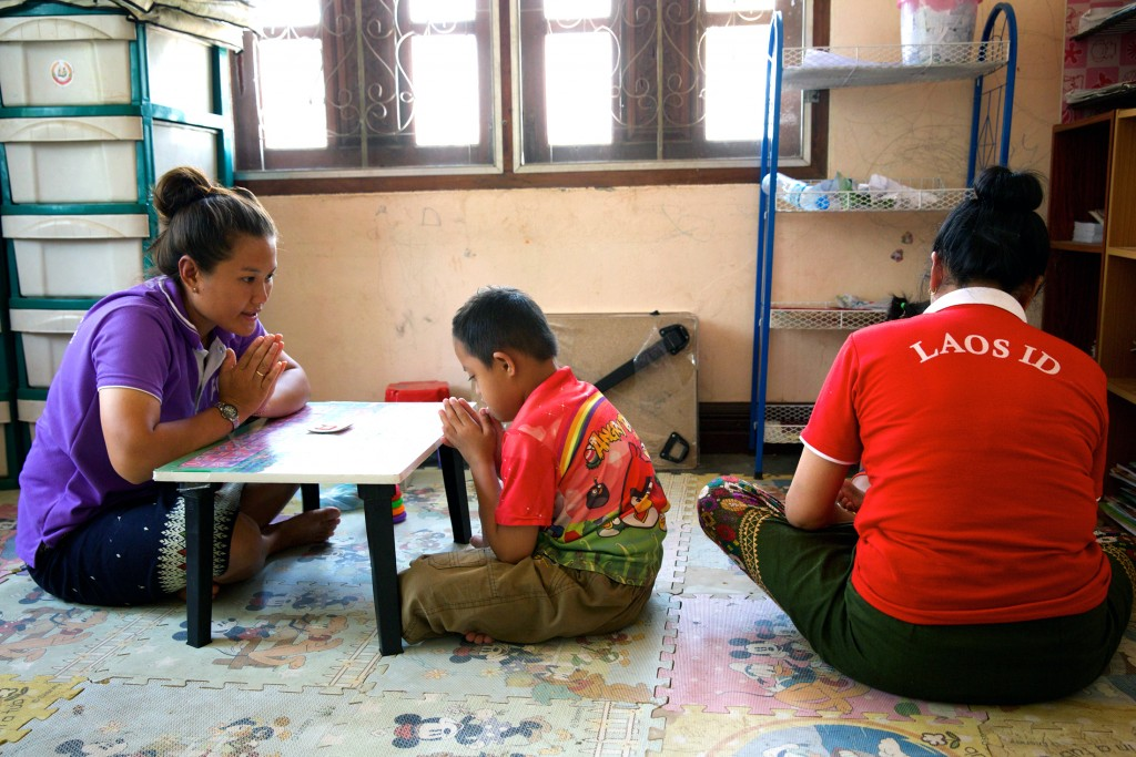 Hum Noy with one of his teachers at the specialist school for children with an intellectual disability, supported by Caritas Australia. Photo: Richard Wainwright