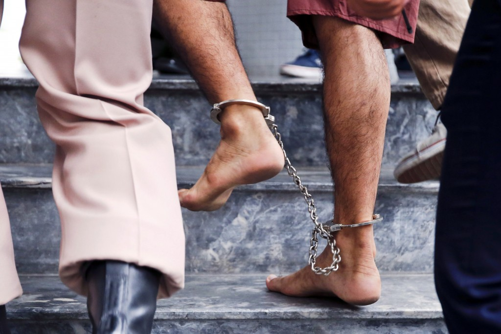 The shackled feet of a bombing suspect in Bangkok, Thailand, are seen as he is escorted by officers and prison personnel to Military Court on 16 February. Pope Francis asks world leaders for a Jubilee Year moratorium on the death penalty. Photo: CNS/Diego Azubel