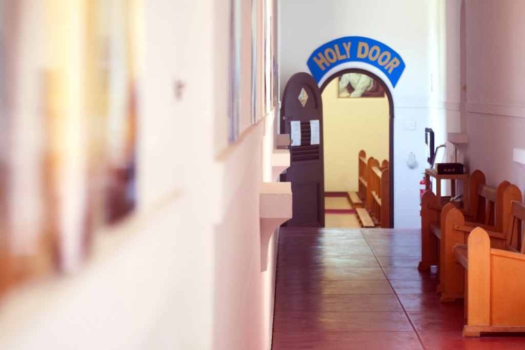 The passage leading to the Holy Door at the Carmelite Monastery's chapel in Nedlands has been adorned with mercy-themed images and quotations, in order to enrich the experience of pilgrims. Photo: Rachel Curry