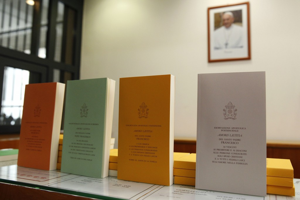 Copies of Pope Francis' apostolic exhortation on the family, 'Amoris Laetitia' are seen during the document's release at the Vatican on 8 April. The exhortation is the concluding document of the 2014 and 2015 synods of bishops on the family. Photo: CNS/Paul Haring.