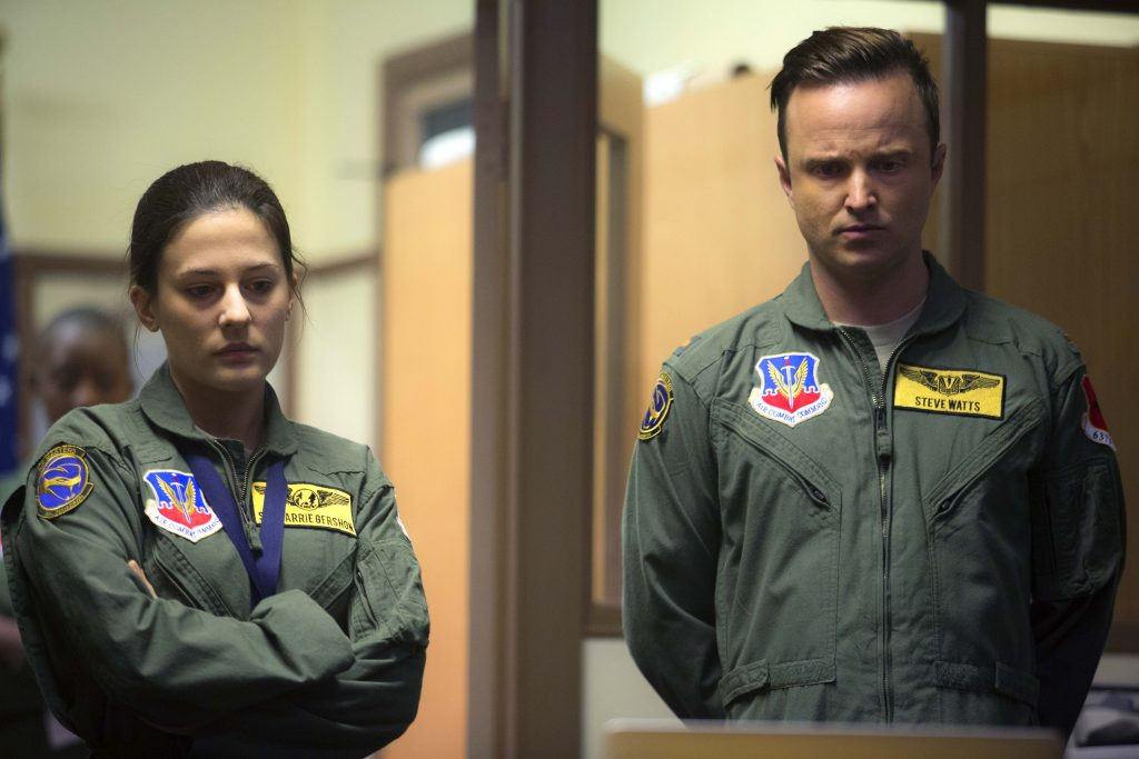 Carrie Gershon and Aaron Paul star in a scene from the movie Eye in the Sky. Photo: CNS/Bleecker Street