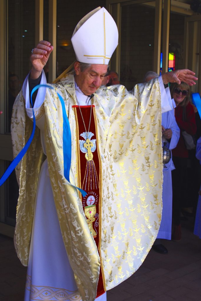 Emeritus Archbishop Barry Hickey cuts the ribbon for St Luke's new Columbarium and grotto. Photo: Francis Deary.