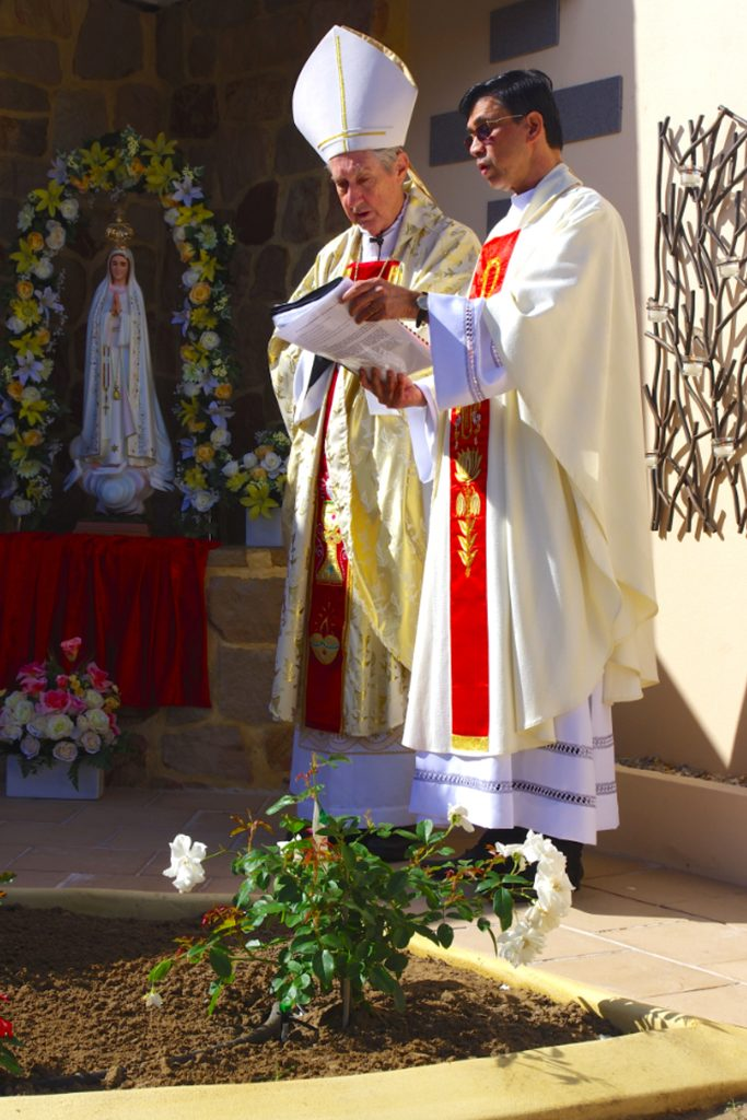 Emeritus Archbishop Barry Hickey and Fr Francisco Mascarenhas open the new Columbarium and grotto at St Luke's Parish. Photo: Francis Deary