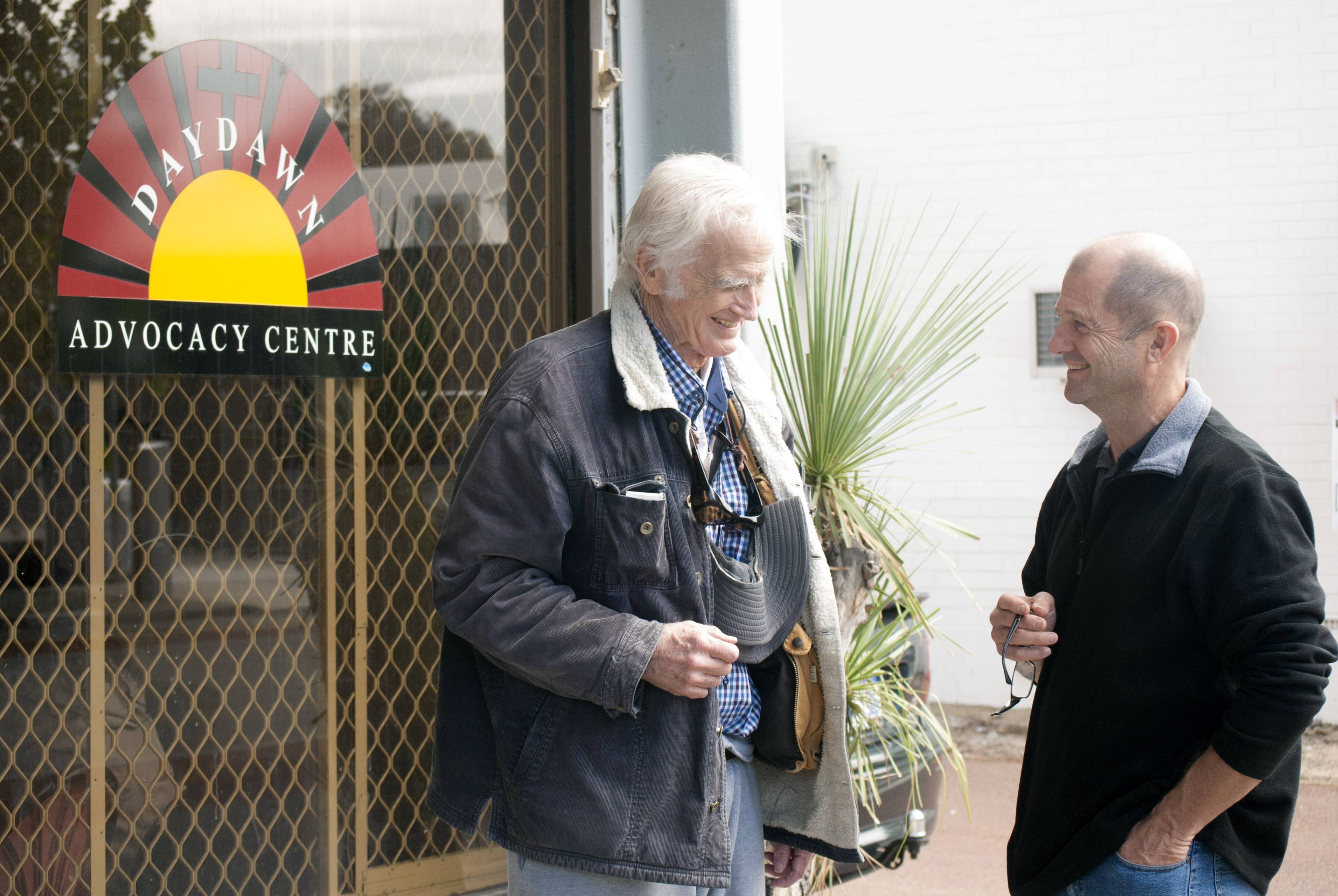 Daydawn Advocacy Centre volunteer David Buchanan and Director Mark Reidy share a laugh. Photo: Rachel Curry