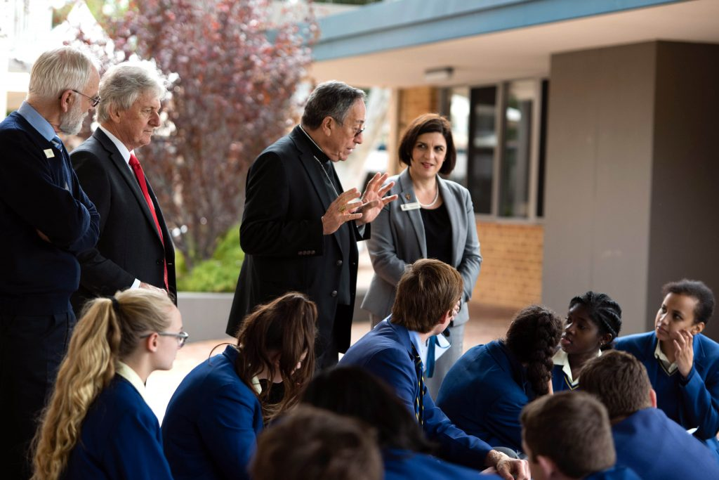 Cardinal Oscar Maradiaga SDB talks to St Norbert College students about the need for a fairer economic system, watched on by (L-R) Catholic Education WA Consultant, Peter Higgins; Acting Principal, Clem Mulcahy, and Deputy Principal, Natasha Quinn. Photo: Chris Richards-Scully