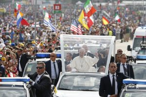 Pope Francis greets the crowd as he arrives to celebrate the closing Mass of World Youth Day at Campus Misericordiae in Krakow, Poland, July 31. (CNS photo/Paul Haring) See POPE-POLAND-WYD-MASS July 31, 2016.