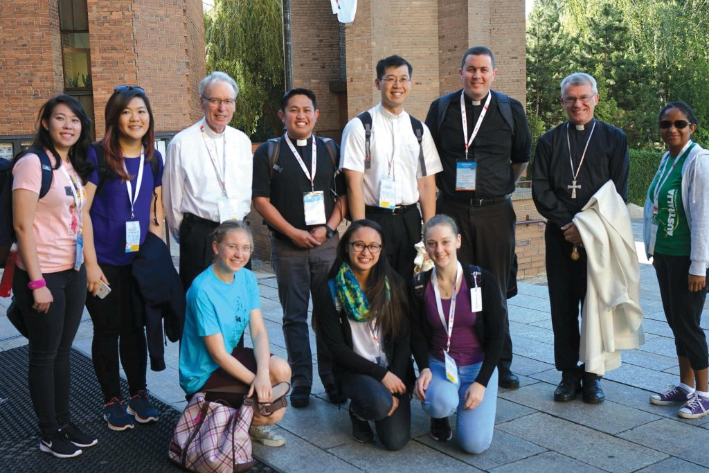 Bishop Don Sproxton, third from left, with Fr Brennan Sia, fifth from left, Fr Mark Baumgarten, and Archbishop Timothy Costelloe, together with youth from Perth during World Youth Day festivities in Poland. Photo: Supplied.