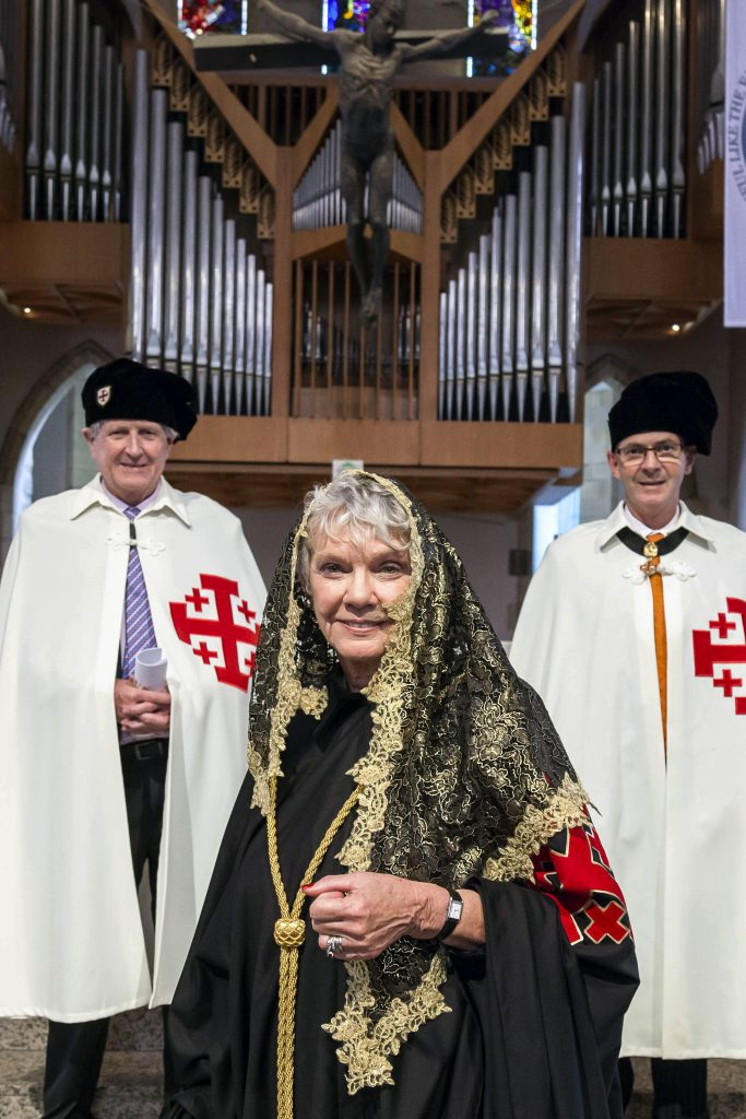 The first female Lieutenant of the Queensland Lieutenancy, Dr Monica Thomson, added a black cape and a gold mantilla to her hooded robes to distinguish herself as the new chapter leader. Photo: Alan Edgecomb/The Catholic Leader