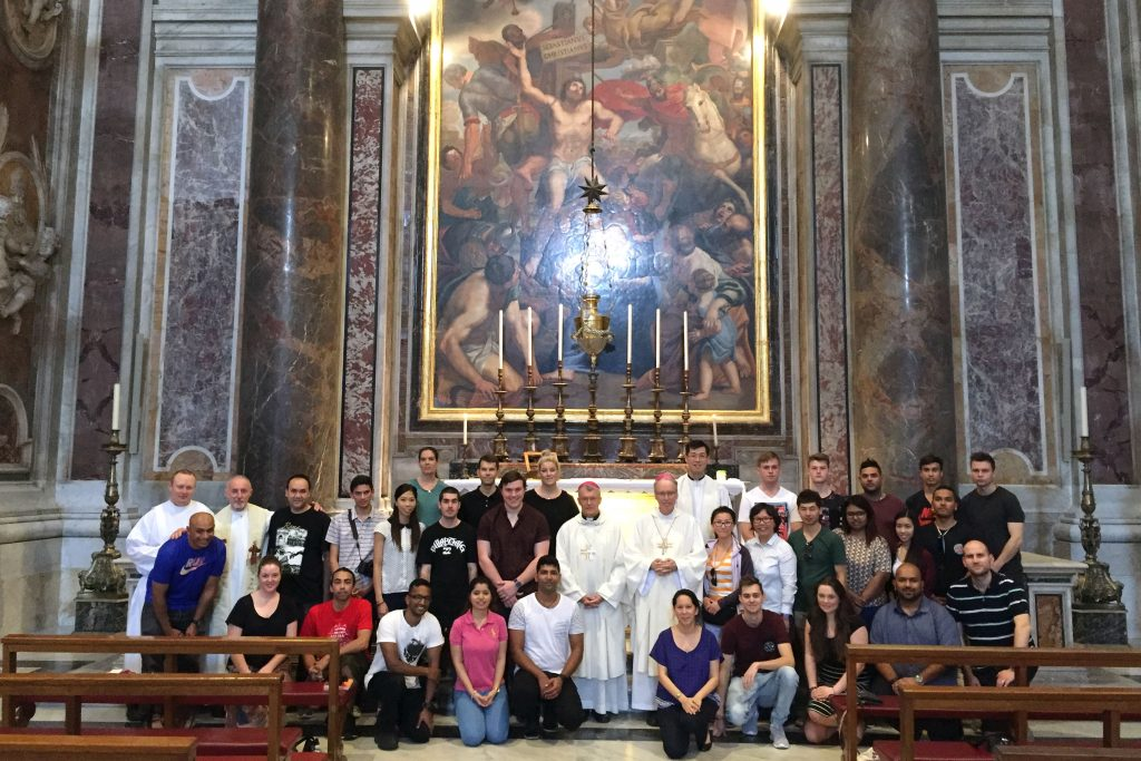 Pilgrims celebrated Mass at the tomb of St John Paul II, in St Peter's Basilica, on their way to Krakow for World Youth Day. Photo: Supplied