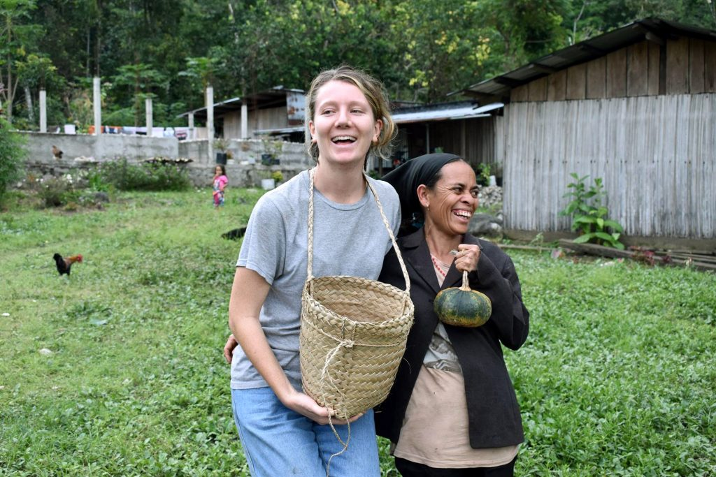Phoebe Whittington collects coffee beans with locals in the town of Same. Photo: Supplied