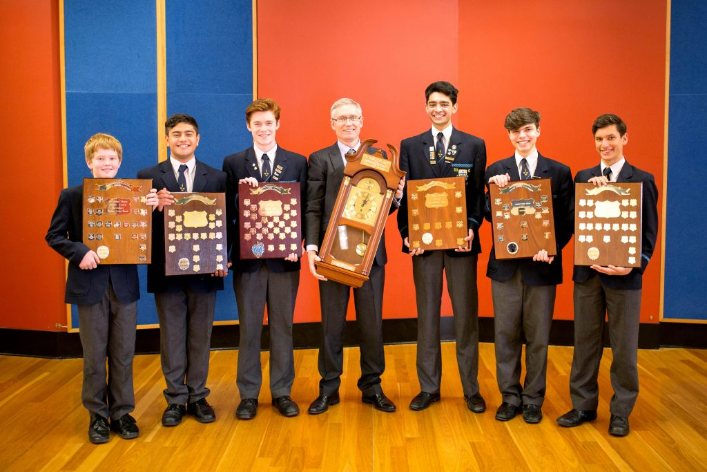 Trinity College Director of Music Dr Robert Braham and Secondary school students with the Zenith award and six shields that they won. Photo: Supplied