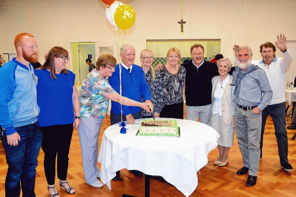 A celebratory cake was cut by Fr Murphy to celebrate his achievements. Photo: Supplied
