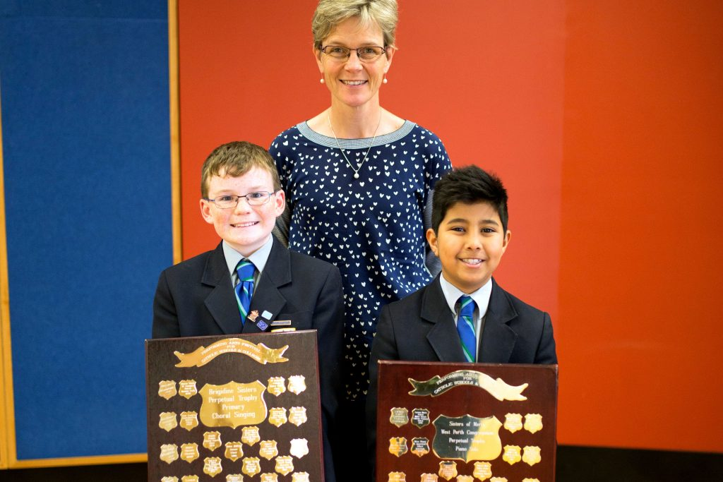 Trinity College Junior School Music Teacher Mrs Ann Clarke and Junior school students with shields that they won. Photo: Supplied