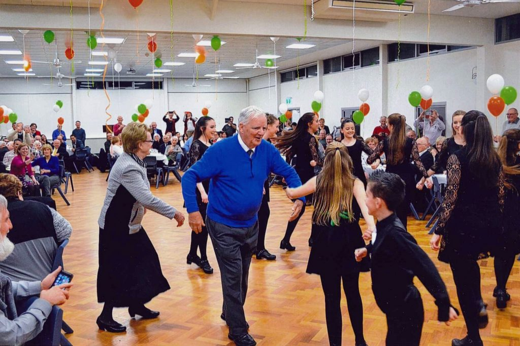 Irish dancing featured among the celebrations for Fr Laurence Murphy's trifecta on Sunday, 9 October. Unwilling to simply watch, Fr Murphy joined in the dancing. Photo: Supplied