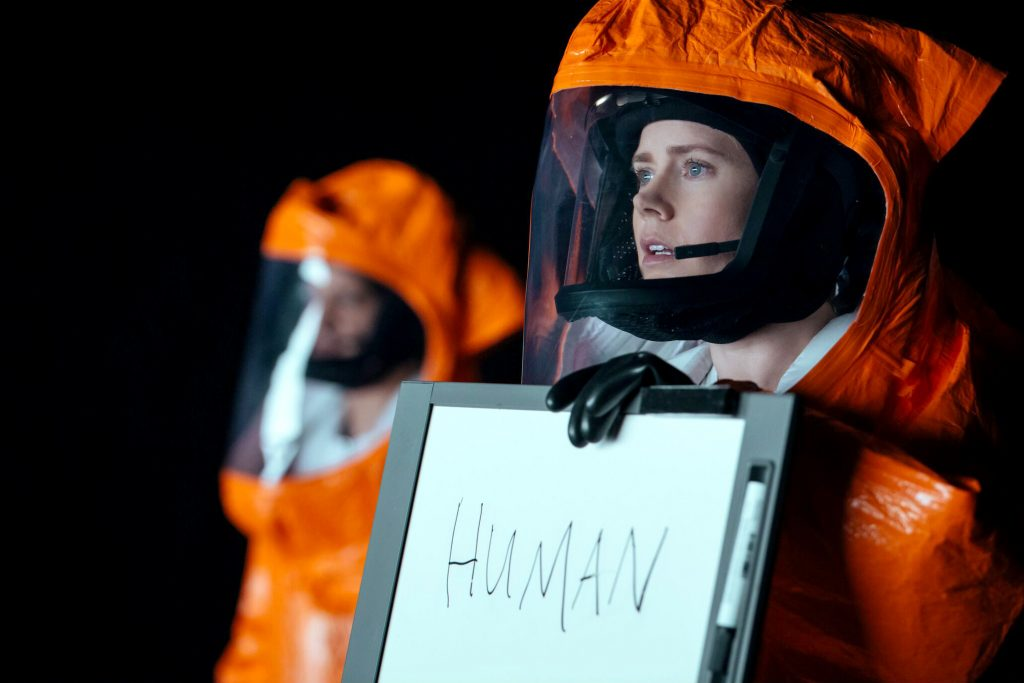 Dr Louise Banks (Amy Adams) shocks her colleagues, as she attempts to teach English to the aliens who have arrived on Earth. Photo: Supplied