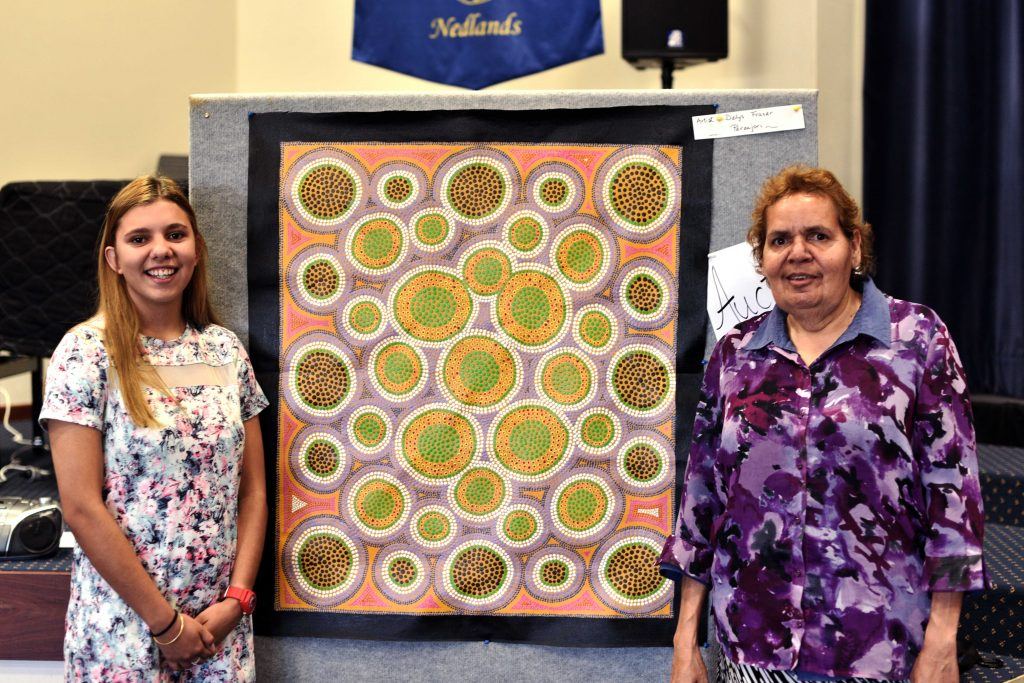 Tamara Gamble (left) has recently graduated from Nagle Catholic College in Geraldton after being sponsored by the Good Samaritan Sisters' Rural Outreach Program. She is pictured with Perenjori artist Delys Fraser, who donated a painting to raise funds for the program. Photo: Frank Lincoln