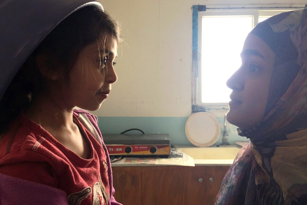 Tasnim (Khadija Al Akel) in conversation with her older sister Layla (Lamis Ammar) in a scene from Sand Storm. Photo: Supplied