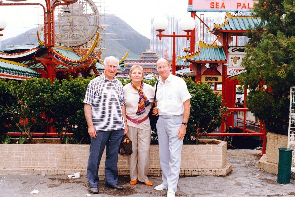 Father Michael Brown (right) was close to his family, including his six siblings. He is pictured with his brother Neil Brown and sister-in-law Margaret Brown in Hong Kong in 1987. Photo: Supplied