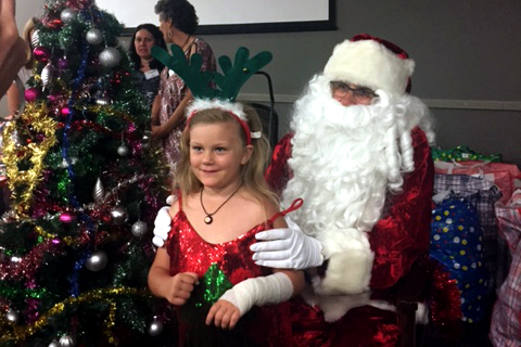 As per tradition, The Shopfront Christmas Party featured the arrival of Santa Claus, who handed out bags of gifts to all those present, giving guests - particularly children - the opportunity to sit on his lap, take photos and for those who wished to do so, exchange a few words. Photo: Supplied