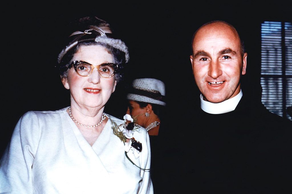 Pictured as a young priest in 1961 with one of his cousins, Father Michael Brown is remembered as a gentle and joyful man whose helpfulness knew no bounds. Photo: Supplied