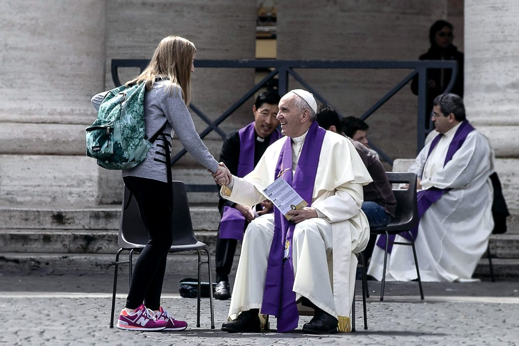 Pope Francis welcomes a young pilgrim before hearing confession April 23 in St. Peter's Square at the Vatican. Youth from around the world flocked to Rome for a special Year of Mercy event for teens ages 13-16. Photo: CNS photo/Angelo Carconi, EPA